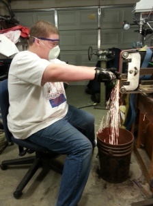 Son, Don hard at work on his first knife!